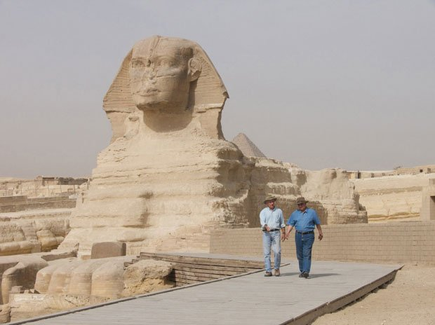 A team of archeologists, including Mark Lehner (left) and Zahi Hawass, carrie...