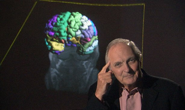 Host and narrator Alan Alda poses in front of his brain scan at the Universit...