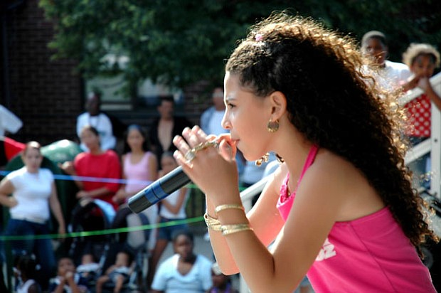 Young rapper P-Star (Priscilla Diaz ), age nine, performs at a Harlem street ...