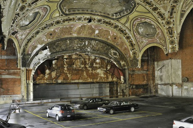 """Correspondent Miles O'Brien says he's saddened every time he returns to the Motor City and sees """"the ruins of a once great city."""" Pictured: Michigan Theatre, now a parking garage."""