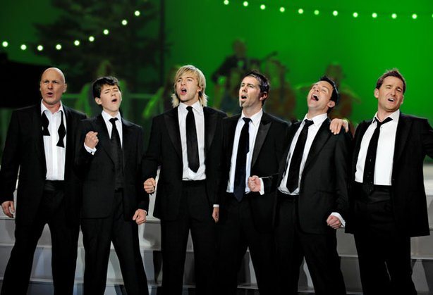 Celtic Thunder, left to right: George Donaldson, Damian McGinty, Keith Harkin, Neil Byrne (Celtic Thunder's guitarist), Ryan Kelly and Paul Byrom