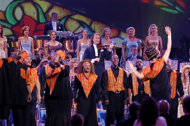 André Rieu, his vocal choir and the Harlem Gospel Choir onstage at Radio City...