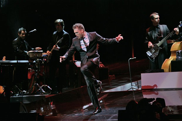 Multi-Grammy-winning phenomenon Michael Bublé (pictured performing on stage) ...