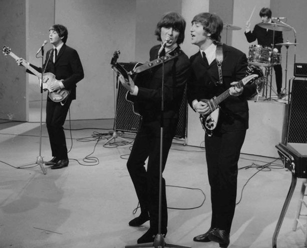 """The Beatles made their American television debut in 1964 on """"The Ed Sullivan Show."""" The Fab Four perform their million-selling #1 chart debut """"I Want to Hold Your Hand,"""" followed by another smash, """"She Loves You."""""""
