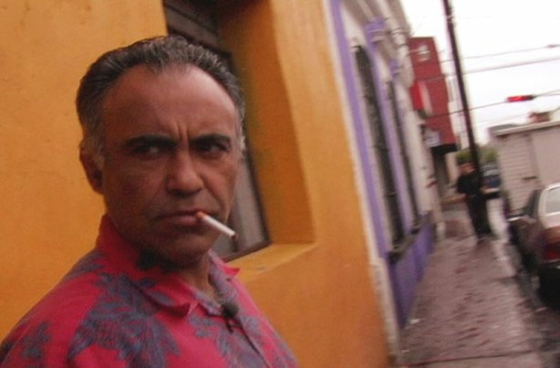 Augie Garcia outside the boarding house where he lived in downtown Guadalajar...
