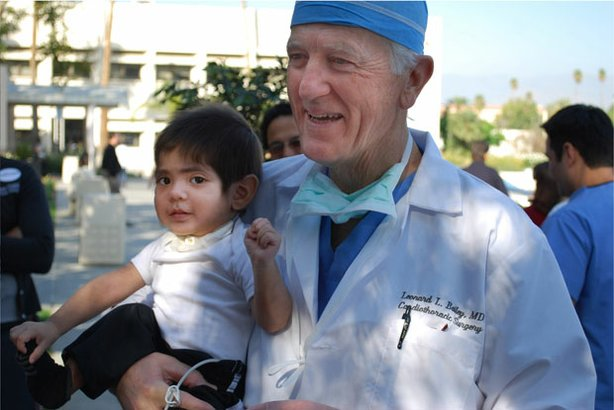 Pediatric heart surgeon Dr. Leonard Bailey holds one of his patients, David E...