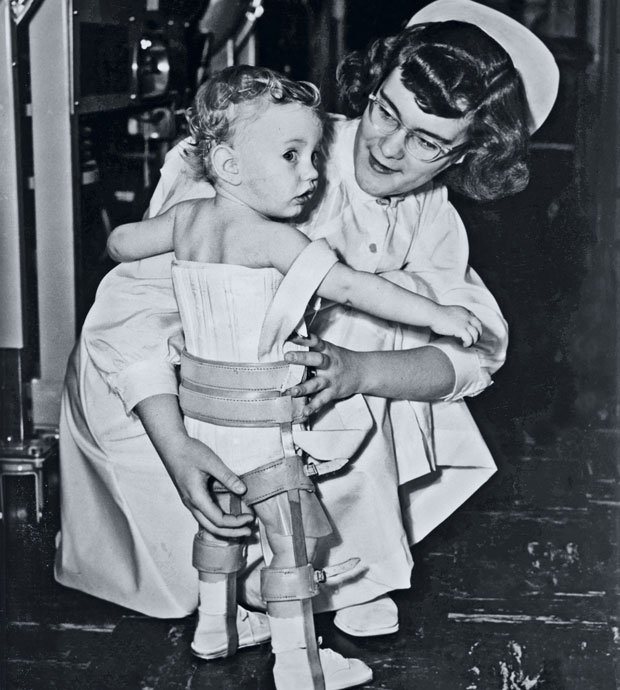 Nurse and child with polio. This program is the story of the largest public h...
