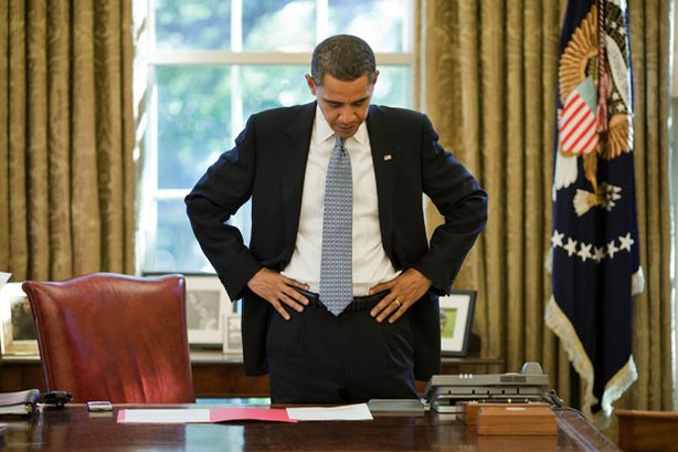 "President Obama stands in front of his desk at the White House. ""Obama's Deal..."