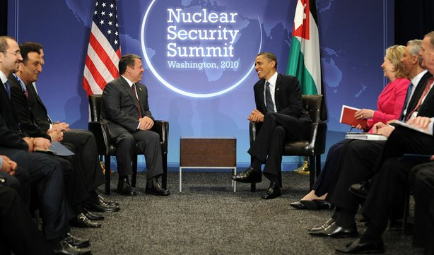 President Obama meets with King Abdullah II of Jordan on the first day of the Nuclear Security Summit in Washington, D.C., as other delegates, including U.S. Secretary of State Hillary Clinton, look on.
