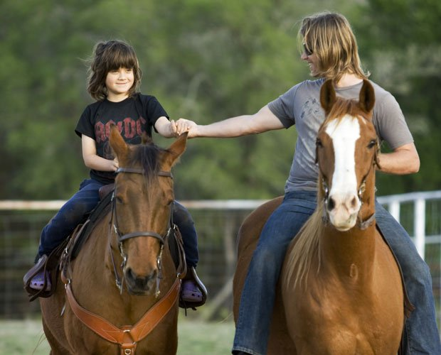 Rowan (left) and Rupert Isaacson riding horses at home in Texas.