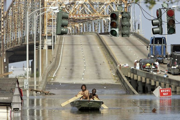 Two men paddle in high water after Hurricane Katrina devastated the area, August 31, 2005, in New Orleans, Louisiana.