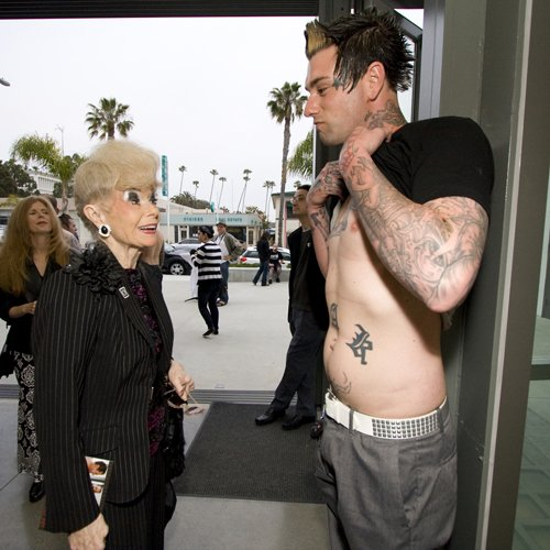 Sally Thornton checks out Matthew Vanerin's tattoos.