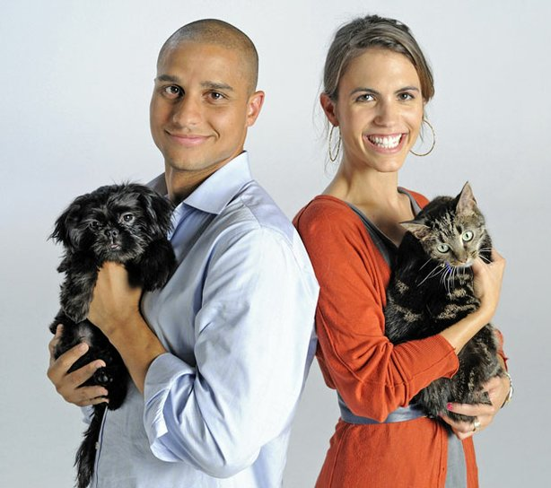 Brian Strong holding a Shih-Tzu puppy named Stabler, and Karie Van Audal with a shy cat named Katy.