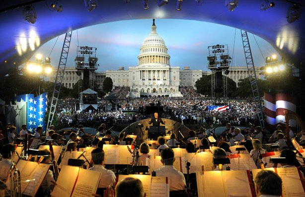 The National Symphony Orchestra before a crowd of thousands attending the National Memorial Day concert at the U.S. Capitol.