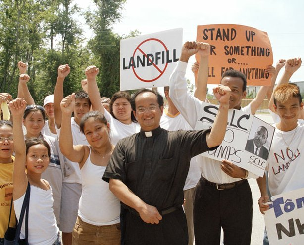Mimi C. Nguyen (far left), Father Luke Nguyen (center) and Versailles youth celebrate victory at the Chef Menteur Landfill protest, 2006.