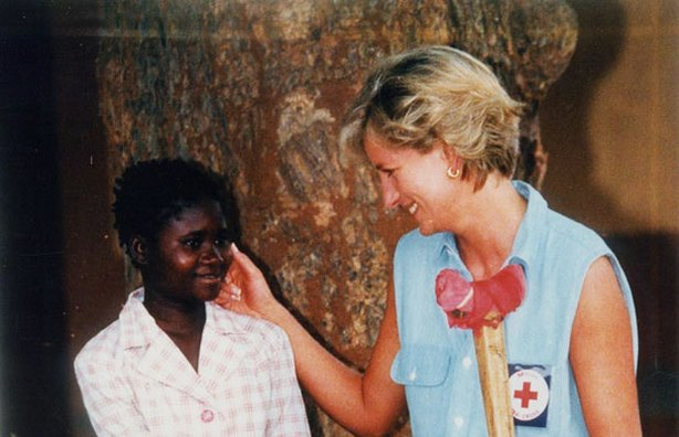 Diana, Princess of Wales talking with a young girl while visiting Angola.