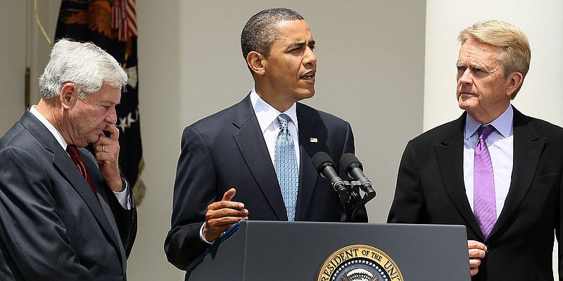 President Barack Obama makes a statement to the media while flanked by Co-Cha...
