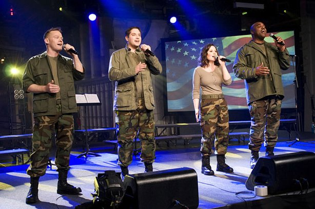 "Pictured (l to r): Former Sgt. Daniel Jens, Former Sgt. David Clemo, Former Cpt. Meredith Melcher, and Staff Sgt. (Ret.) Ron Henry. 4TROOPS is a new pop vocal group made up of United States combat veterans who served on the front lines in Iraq and Afghanistan. ""4TROOPS: Live From The Intrepid"" is the group's debut performance special and features an inspirational repertoire of well-known patriotic, pop and crossover hits."