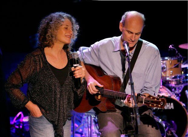 Carole King and James Taylor performing on stage together at the Troubadour n...