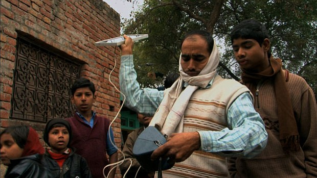 Customers of the social enterprise D.light Design in India test its solar-pow...