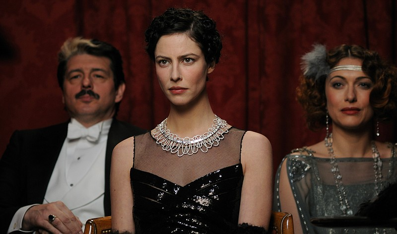 Grigori Manoukov as Sergey Diagilev  and Anna Mouglalis as Coco Chanel watch ...