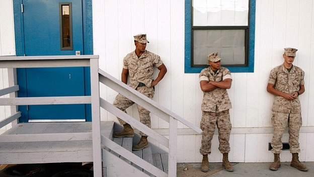 Marines wait outside a building to take psychological tests in September 2009...