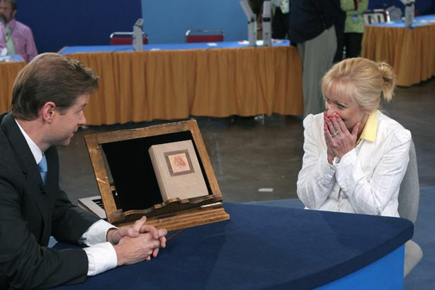 "At ""Antiques Roadshow"" in Providence, Rhode Island, appraiser Francis Wahlgren of Christie's (left) uncovers a copy of the book ""Anne of Green Gables,"" bought at a flea market for about $5 and since stored in an attic. The owner and her daughter fell in love with the story, having seen the series on PBS, and the owner's appreciation only intensifies as she learns the volume is a rare 1908 first edition valued at $12,000 to $18,000."