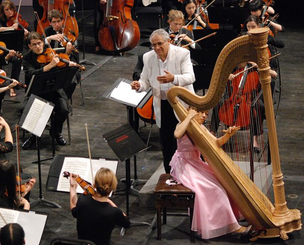 Conductor David Effron leads the University Summer Festival Orchestra while H...