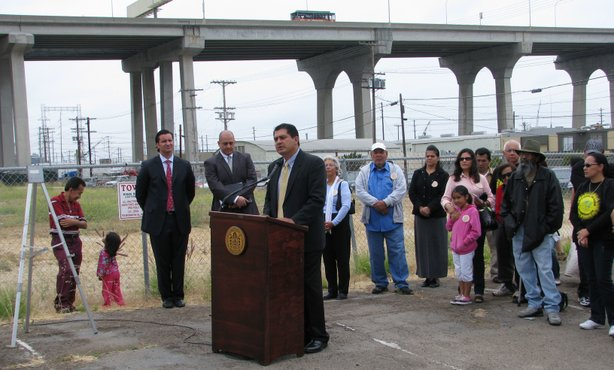 City Council President Ben Hueso stands at the site of the Mercado Project and explains to reporters and residents how the development plan will help transform Barrio Logan, June 29, 2010.