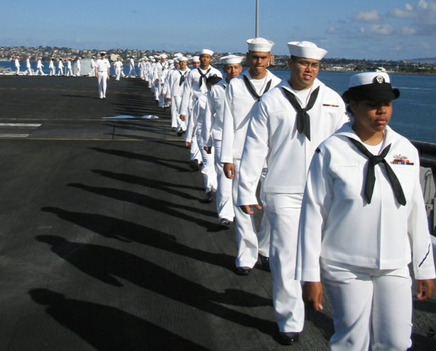 """Carrier,"" a 10-part series filmed aboard the USS Nimitz , is a character-driven immersion in the high-stakes world of a nuclear aircraft carrier. Pictured: Sailors ""manning the rails"" aboard the ""USS Nimitz."""