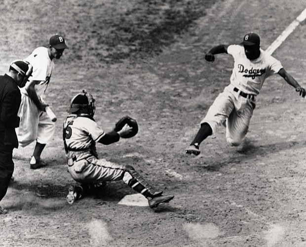 Jackie Robinson slides home for the Brooklyn Dodgers.