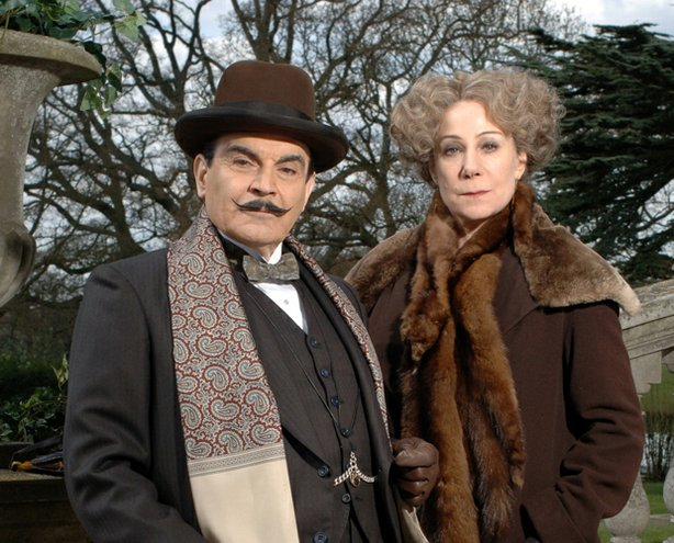 """David Suchet as Hercule Poirot and Zoë Wanamaker as Ariadne Oliver in MASTERPIECE MYSTERY! """"Poirot X: Third Girl."""" A demon-haunted heiress is convinced she has committed murder, but Poirot believes she is  innocent. Eccentric crime novelist Ariadne Oliver helps the great sleuth crack the case."""