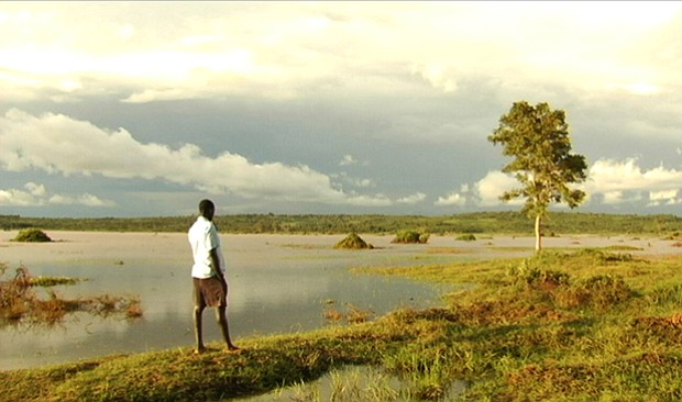 Jackson Omondi observing the floodwater from the edge of his property in the ...