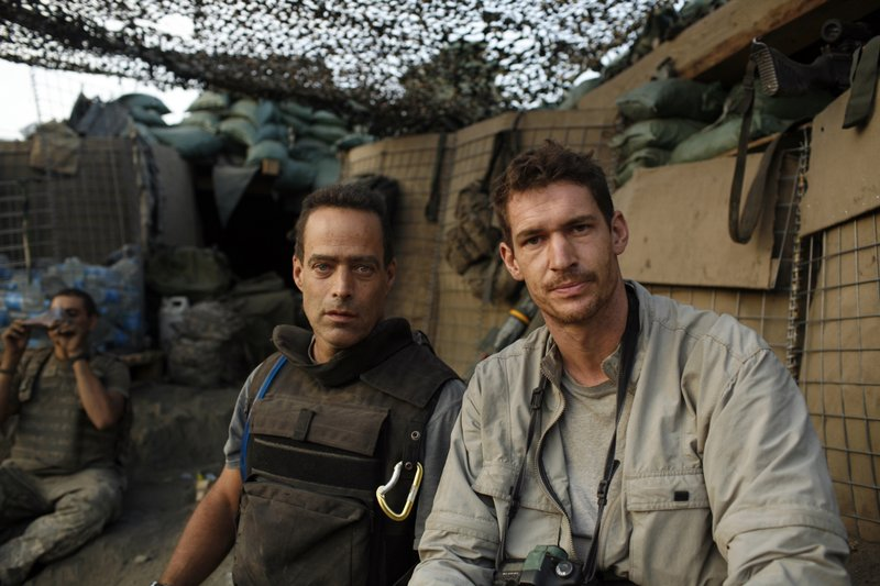 Filmmakers Sebastian Junger and Tim Hetherington at Outpost Restrepo.
