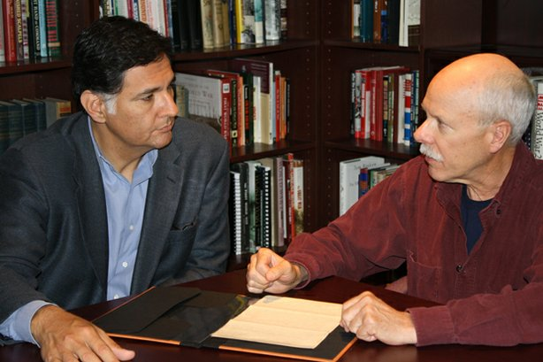 HISTORY DETECTIVES host Eduardo Pagán (left) shares a letter with Hal Barker ...