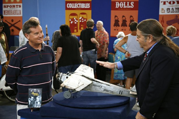 "At ""Antiques Roadshow"" in Las Vegas, Nevada, the owner (left) brings an iconic movie prop. Purchased for $195 at a southern California swap meet, the plane is identified as the Barranca Airlines prop plane used in the Howard Hawks film ""Only Angels have Wings"" - starring Cary Grant and Rita Hayworth - the Oscar winner for Special Effects in 1940. Appraiser Noel Barrett of Noel Barrett Antiques declares the model a legendary piece of movie magic, awarding it a value of $4,000 to $5,000."