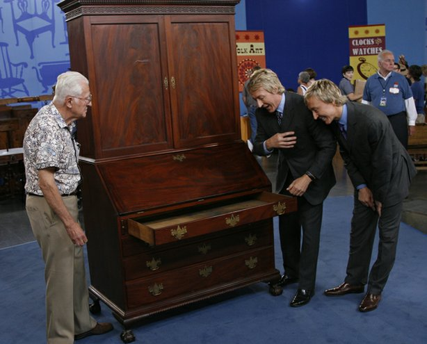 "At ANTIQUES ROADSHOW in Milwaukee, Wisconsin, appraisers Leigh and Leslie Keno, of Leigh Keno American Antiques and Sotheby's respectively, team up to evaluate this desk and bookcase, passed down to the owner from his great-grandfather, Richard D. Hubbard, a former governor of Connecticut. The piece is a classic example of New York 18th-century design and cabinetmaking and even has a secret drawer for hiding valuables. One question remains: Have the top and bottom been ""married,"" or is the entire piece original? Pending further investigation, the Kenos offer a range of auction values from $20,000 to $250,000."