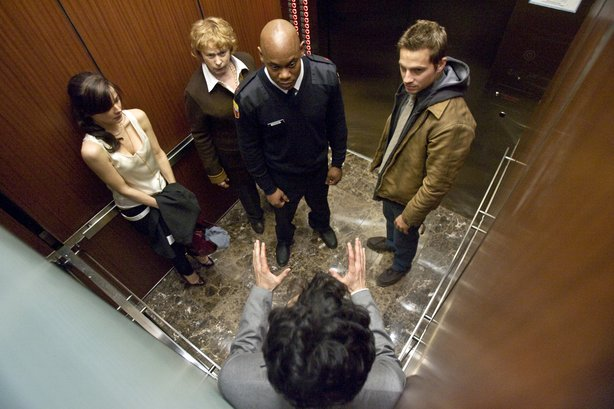 "A group of people are trapped in an elevator in the new film ""Devil."""
