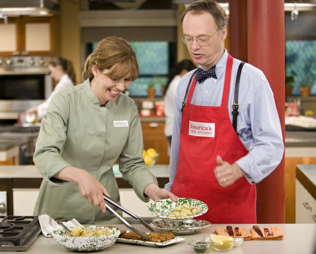 Host Christopher Kimball with cook Rebecca Hays in the test kitchen.
