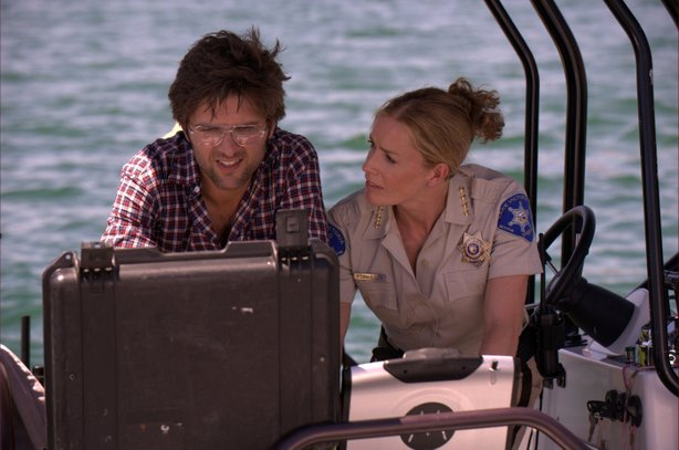 "Sheriff Julie Forester (Elizabeth Shue) asks, ""There's what in my lake?"" in ""..."
