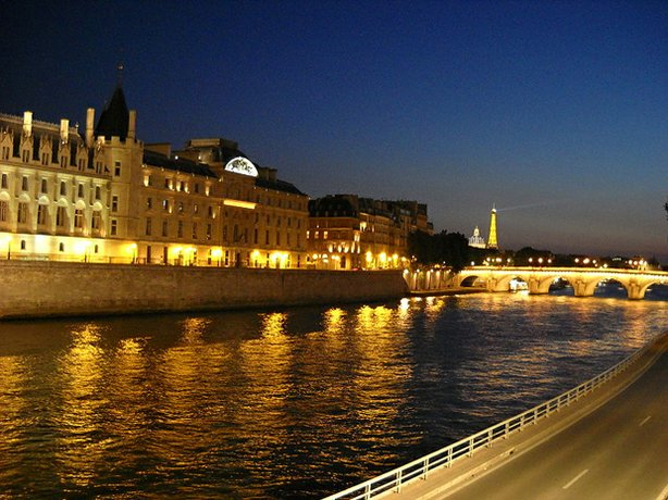 Photo taken at night of the Seine and Eiffel Tower, in France, July 7, 2009.
