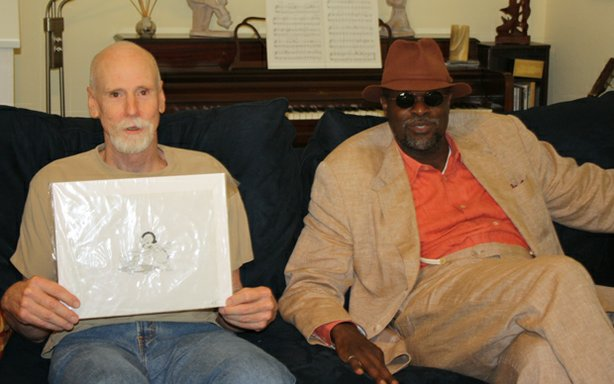 HISTORY DETECTIVES host Tukufu Zuberi (right) helps Bruce Cockrill (left) identify the characters in this animation cell, and investigates the role they played in animated cartoon history.