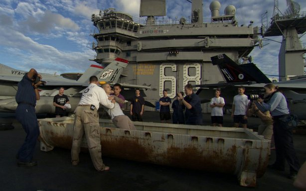 "A sailor is baptized aboard the ""USS Nimitz."" ""Carrier,"" a 10-part series filmed aboard the ""USS Nimitz,"" is a character-driven immersion in the high-stakes world of a nuclear aircraft carrier."