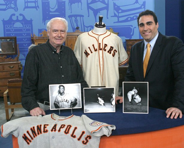 "This ""Roadshow"" special edition recalls such spectacular windfalls as this authentic 1951 Minneapolis Miller's player uniform worn by the Say Hey Kid, Willie Mays, in his pre-Giants career, brought to the ""Roadshow"" event in St. Paul, Minnesota. The owner, who acquired the garments for $50 and conducted some ""forensic analysis"" with a photo and a magnifying glass, discovers he's hit one out of the park when appraiser Simeon Lipman (right) of Heritage Galleries reveals the uniform's staggering value of $60,000 to $80,000."