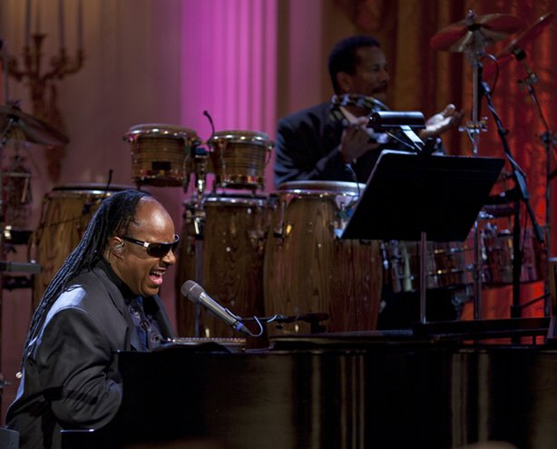 A photo of Stevie Wonder performing live at the White House on February 25, 2009. This special showcases an evening with President and Mrs. Obama at the White House in honor of musician Stevie Wonder's receipt of the Library of Congress Gershwin Prize for Popular Song.