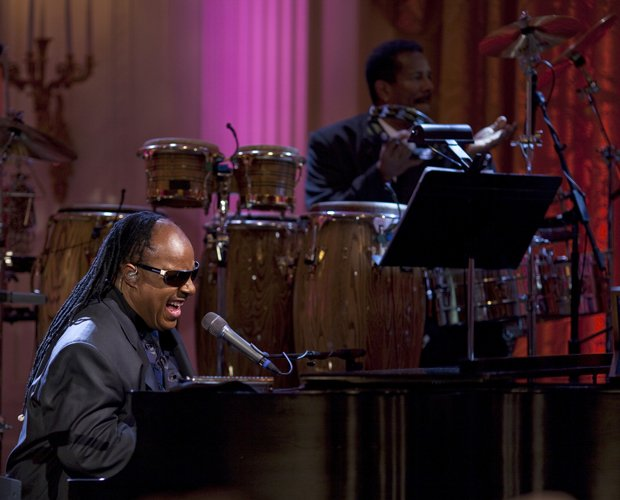 A photo of Stevie Wonder performing live at the White House on February 25, 2...
