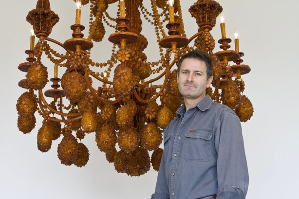 """Sculptor Timothy Horn in front his 2008 sculpture """"Diadem,"""" a chandelier covered in 300lbs of crystallized rock sugar. """"Diadem"""" is currently on view at the Lux Art Institute in Encinitas where Horn is artist-in-residence."""