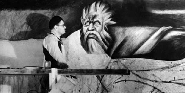 Black and white photo of Mexican muralist José Clemente Orozco at work painti...