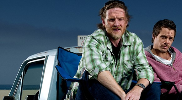 Private Detectives Hank (Donal Logue) and Britt (Michael Raymond-James) relax...