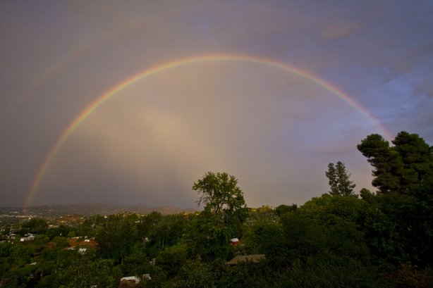 A rainbow materialized early Thursday evening after a day of rain. Seen from ...